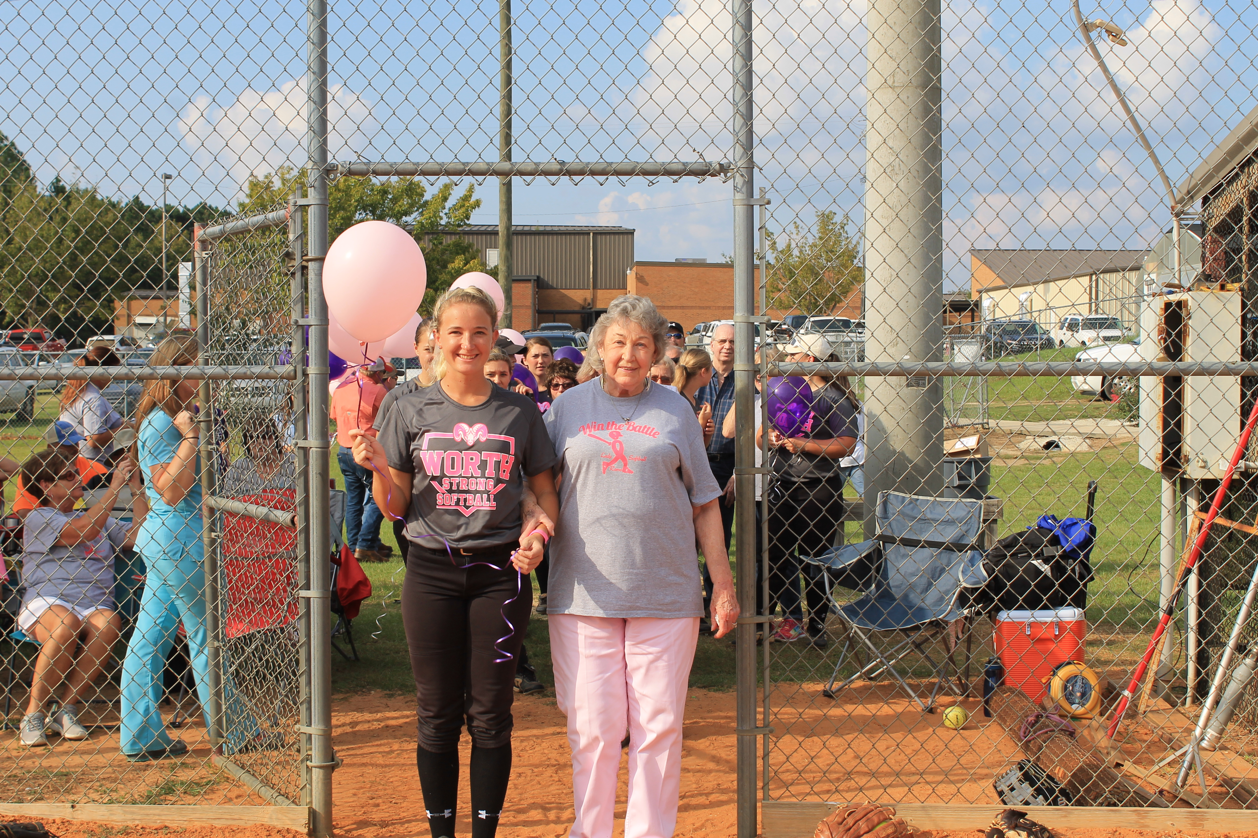 Taylor Layfield is escorting Faye Knight.  She is a survivor of breast cancer.