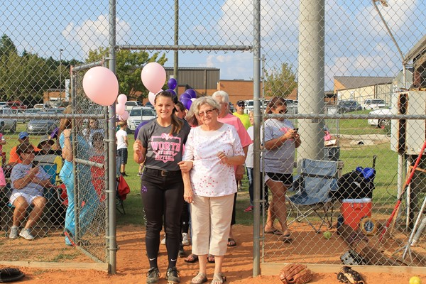 Caroline Newton is escorting Diane Douthit.  She is a survivor of breast cancer.