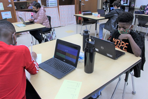 Students participate in math by using an online game, Gimkit.