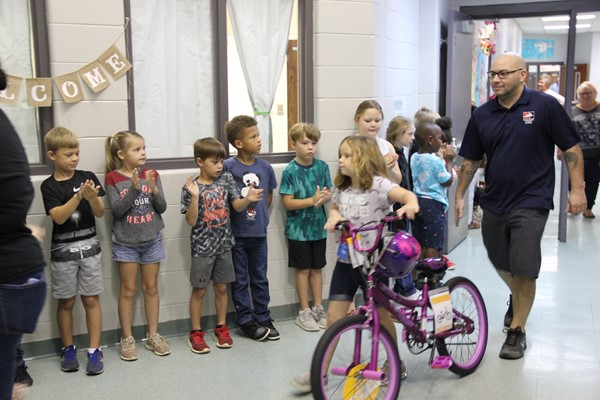 students and parents for bike give away