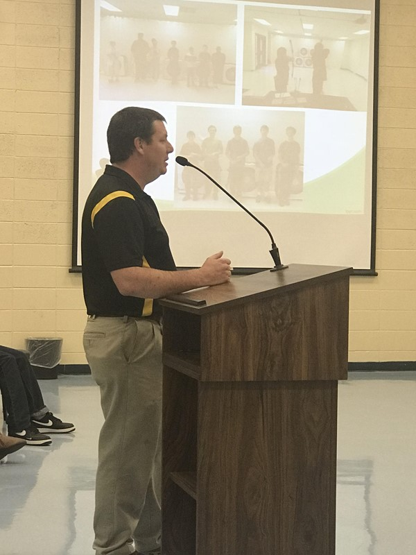 Mr. Sherrard presents the archery program at the BOE meeting.