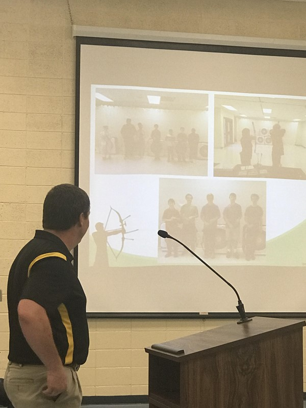 Mr. Sherrard presents the WCMS archery program at the BOE meeting.