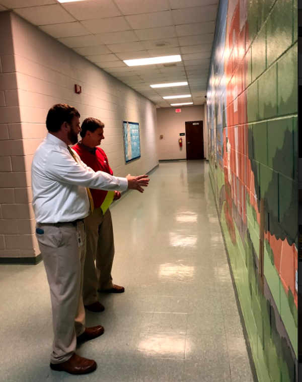 People viewing wall art at WCPS